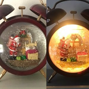Musical light up clock shaped snow globe Santa